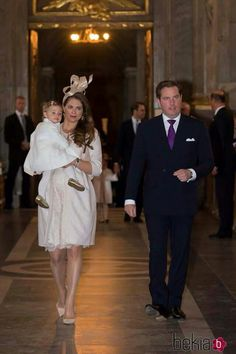 8-month pregnant Princess Madeleine of Sweden carries her daughter, Princess Leonor, into the Marriage Banns ceremony of her brother, Prince Carl Philip and Sofia Helqvist, accompanied by her husband Christopher O'Neill, 17 May 2015.