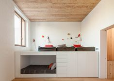 H Arquitectes wedges home between walls of existing houses. kids room