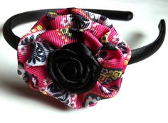 Girl's Headband with a Pink and Black Patterned Flower and Rosette Center. $10.00, via Etsy.