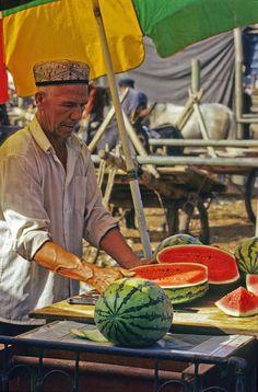 Watermelon seller at Kashgar Market, China | Photo by Photographer vezio paoletti - photo.net  Kashgar, China
