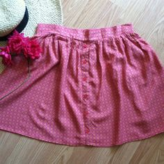 """Mossimo pink patterned summer skirt Fun and flouncy, this a perfect piece for summer! Decorative buttons down the front. Elastic back. Deep hot pink with a fun print in accent colors of light pink and yellow. 100% rayon. 17""""L. 15"""" waist unstretched. Size large, could also fit a medium. Mossimo Supply Co. Skirts"""