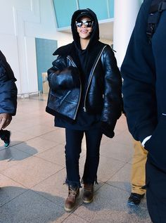 Shearling Coat + Sweatshirt + Trousers + Moto Boots: If you reside somewhere that often has below-zero temps, Rihanna's look is perfect for you. Try a massive parka, sweatshirt, jeans or trousers, and weather-resistant boots. (The Best Mellow Winter Outfits, According to Celebs via @WhoWhatWear)