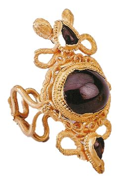 Ptolemaic gold serpent finger ring with a garnet setting, 1st cent. BC