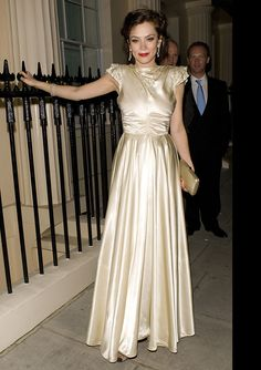 "Anna Friel Photos Photos - Actress Anna Friel wears a gold dress outside the Haymarket Hotel during the after party for the opening night of her new play ""Breakfast At Tiffany's"" at the Theatre Royal. - Anna Friel Outside Haymarket Hotel"