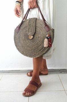 Round juta cord bag crochet tasseled handbag summer tote circular purse circle bags custom madeRound Juta Cord Crochet Bags have rapidly become the hottest summer trend. They are the perfect choice to use during a beach day or any evening summer outing. Crochet Purses, Crochet Bags, It Bag, Round Bag, Basket Bag, Everyday Bag, Custom Bags, Handmade Bags, Purses And Handbags