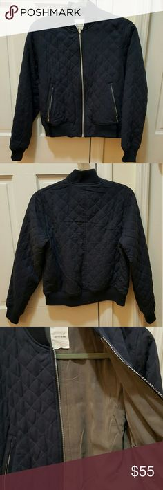 Wood wood hazel bomber jacket, navy, size small Worn once, in very good condition with no noticeable signs of wear. Dark navy, with a grey lining. Cropped, oversized fit. Soft and comfy! Retailed at $450.  ?	Reversible bomber style jacket ?	Quilted exterior ?	YKK zip closure ?	Zip welt front waist pockets ?	U-shaped interior patch pockets ?	Ribbed collar, cuffs, and hem  ?	100% Tencel  ?	Dry clean only Wood Wood Jackets & Coats