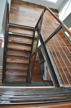 This custom designed staircase features horizontal railings, a solid black… Wood Railing, Railings, Home Reno, Walnut Wood, Basement Ideas, Solid Black, Custom Design, Channel, House Ideas