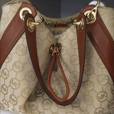 Michael Kors Bag  Authentic Cute bag with plenty of room. NEW with tag.... Michael Kors signature Collection. You will love this bag it will carry all of your essentials and more.... Fits perfectly on your shoulder. Michael Kors Bags Shoulder Bags