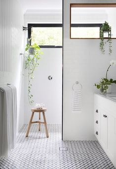 Indoor greenery plants and trailing hearts plant in modern white and black bathroom with timber stool in stunning Brisbane home the combines classic features with a modern feel. French Oak, Australian Homes, New Builds, Outdoor Pool, Brisbane, Home And Living, Living Area, New Homes, Indoor