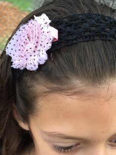 This is one of our shabby chic polka-dot bow line that is being worn with a crochet headband. Visit etsy.com/shop/paisleygirlbowsllc to get an exclusive look at our products!