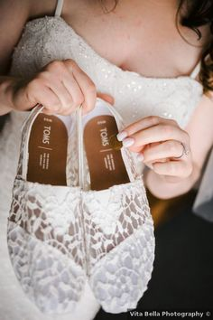 White flats for wedding- white lace TOMS for wedding day - See more fall wedding ideas on WeddingWire! {Vita Bella Photography}