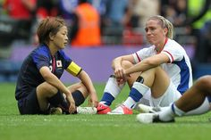 Being a winner is just one quality. Gotta love this image. A credit to women's football.  Japan's captain MIYAMA sits with France's CAMILLE ABILY after her side beat the French in the London 2012 Olympic SF at Wembley. They were team mates at the LA Sol in the WPS. (TGSPHOTO/SHEKICKS.NET)