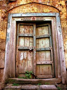 there is something very powerful held in this image... an indian door.  Imagination soars with what is behind it