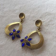 Stunning handmade floral earrings NWOT these stunning floral earrings were handmade in India. The floral design is blue (green photo is only for size reference, but I also have those available as well), and the whole earring is gold tone with a beautiful finish. Handmade in India Jewelry Earrings