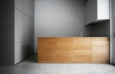 minimalist grey and wood kitchen