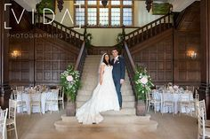 Bride and groom on the grand staircase at Buckland hall.