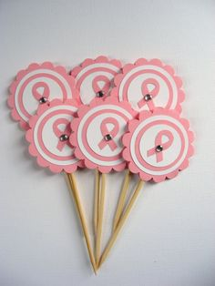 @Peggy Magness Webb I could make these for you if you ever wanted me to! Pink ribbon toppers