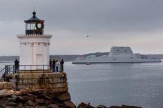 Spectators watch from Bug Light in South Portland as the USS Zumwalt, a…