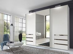 instrument KENAI white wardrobe with mirror  (W300 x D65 x H216) - Planked oak matt finish  - 3 Sliding doors, 1 mirrored door  - 3 Hanging rails are included - 6 drawers - 5 Shelves  - Made in Germany