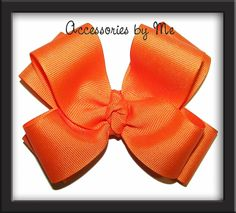 "#Cheerleader Girls Solid Hair Bow   Shown in an Orange 4.5"" Double Layered Grosgrain Bow attached to a choice of an alligator, locking barrette or Ponytail holder    Cheer Bow is Perfect for Cheer Teams, Football, Volleyball, Soccer, School Spirit, Bitty Teams, Grammar & Middle School, High School, College Teams, Sorority & Fundraising. $8.99 Buy more Save More"