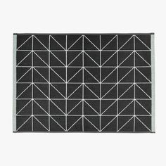 Adorn your modern bathroom with the demure geometry of the plush cotton Kami Bath Mat, Charcoal from Aura by Tracie Ellis.