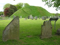 The Bass of Inverurie with Two of the Pictish Stones in the Foregound. Anyone driving past the cemetery will inevitably notice two very large mounds projecting above the gravestones. These are together known as the Bass of Inverurie, and supported the motte and bailey castle built by the Earls of Garioch in the 1100s. The castle here was used as a base by Robert the Bruce before his defeat of the Earl of Buchan in May 1308 at the (first) Battle of Inverurie, a battle often known - because it…