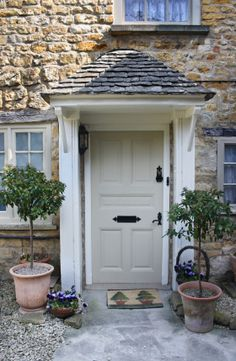 Door canopy ( note paint color is Farrow and Ball Bone for this putty-coloured front door. Doors, Cottage Door, Front Door Colors, Front Door, Cottage Exterior, Stone Cottages, English Cottage, Door Canopy, House Front