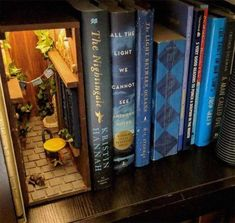 This cool little alley stashed at the edge of this row of books. Book Nook Shelf Inserts Are Really Cool, And Everyone Should Know They Exist — Here Are 14 Of The Most Creative Ones You'll See Book Crafts, Diy And Crafts, Vitrine Miniature, Miniature Rooms, Theme Harry Potter, World Of Books, Fairy Doors, Fairy Houses, Book Nooks