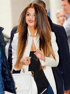 Selena Gomez puts her long locks front and center Wednesday while arriving to Londons BBC Radio 1 studios.