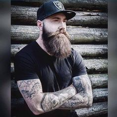 Daily Dose Of Awesome Beard Styles From Beardoholic.com  he.....ok double brownie points for me because he is wearing a RAIDERS cap
