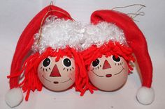 Shirley's Raggedy Ann & Andy in red santa hats made from felt. light bulb inspired