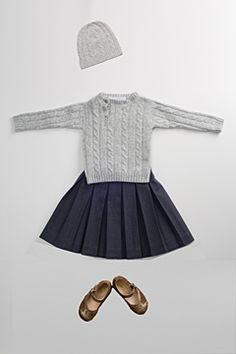 For the little ones: cable sweater with navy pleated skirt