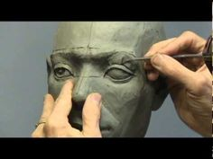 Carter R Jones FNSS demonstrates the sculpting of a human eye in clay. little different way for eyes