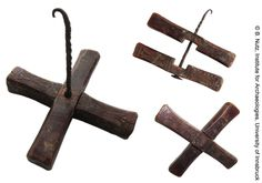 "Albania. Cross spindle with twisted iron shaft. The arms, one of them decorated with carvings, are inserted into each other and can be taken apart and rotated. This makes it possible to store the spindle in a flattened position that needs less space. The hook however prevents a complete disassembly of the spindle as it is possible with Turkish spindles. Length of the arms: 5.5""; Length of the iron shaft: 4.92""; Weight: 134.30 g."