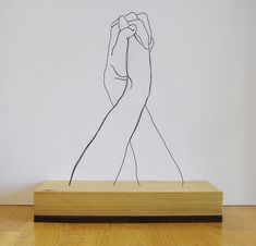 "Gavin Worth ""Hands Clapsed"" - Steel wire and poplar"