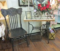Sewing machine base and six-pane window repurposed into a lovely table.  Love this vignette!