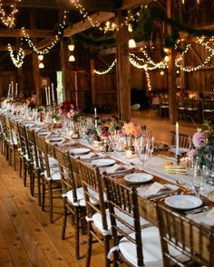 """See the """"Autumnal Accents"""" in our A Rustic Fall Barn Wedding in Maine gallery--Seasonal centerpieces adorned the tables at the reception. Flora Fauna designed loose arrangements that were placed atop the linen runners. The displays included thistle from Scotland and foraged leaves."""