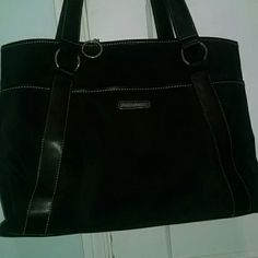 HUGE Nine West bag This bag is HUGE!!! It's durable black microfiber with a ton of pockets and places for cards, pens, keys, phone ect. EUC With no rips stains snags or flaws.  Great for work and school. Nine West Bags