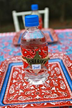 Drinks at a Cowboy Party #cowboy #partydrinks I love this idea, they get a sheriff badge on their water bottle :)