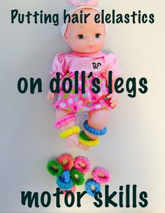 Put hair elastics on doll legs/hands, list of activities for toddlers, activities for 18-24 month old, activities for one year old, activities for 18 month old, activities for 19 month old, activities for 20 month old, activities for 21 month old, activities for 22 month old, activities for 23 month old, activities for 24 month old, activities for two year old, toddler games