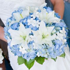 Blue hydrangeas and white lily bouquet