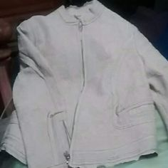 Peter Nygard  lazer cut leather jacket Soft figure forming lazer cut cream colored leather waist length jacket..its beautiful and the work on it is outrages...won't find another like this one ladies paid $475.00 at Saxs 5th ave peter nygard Jackets & Coats