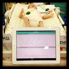 The Peeko is a baby monitor that uses sensors embedded in a onesie (they don't actually touch the baby) to monitor breathing, body temperature, movement, and sleep patterns. All data is sent to iOS devices for tracking and alarm purposes.