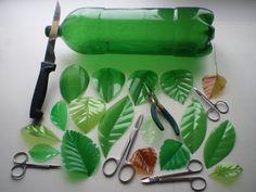 Recycled green plastic bottles cut or burned into leaf shapes – Artofit Reuse Plastic Bottles, Plastic Bottle Flowers, Plastic Bottle Crafts, Plastic Art, Diy Bottle, Recycled Bottles, Recycled Crafts, Diy And Crafts, Arts And Crafts