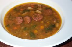 white beans 2 large onions 3 medium carrots 1 bunch celery chopped 2 ripe tomatoes or equivalent chopped 1 cup olive oil 2 lemons Village Maniatika sausages, sliced Salt and pepper Bean And Sausage Soup, Slow Cooker Beans, White Beans, Chana Masala, Soups And Stews, Celery, Carrots, Vegetables, Diet