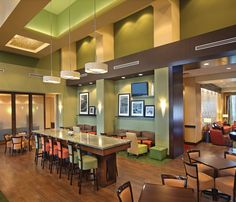 Enjoy a Free Breakfast with your stay at Hampton Inn & Suites with seating in the dining room or poolside lanai.