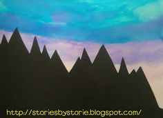 Sunset Silhouettes - using black construction paper silhouettes over watercolor backgrounds
