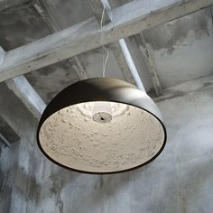 Skygardens light with black outside and cast plaster with decoration inside. Designed by Marcel Wanders for Flos.
