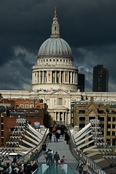 St Pauls Cathedral and the Millennium Bridge taken from a window of the Tate Modern - London, UK,