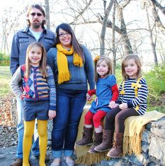 family photo pose, family picture outfits colors, grey navy mustard red outdoor fall